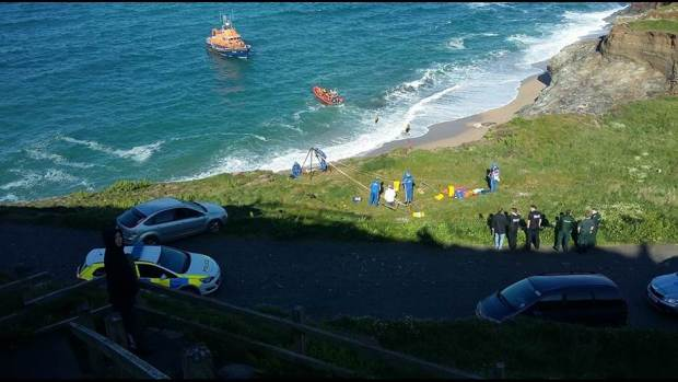 penlee_rnli_volunteers_help_to_recover_casualty_from_beach_at_porthleven.jpg